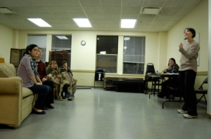 Director Annie Sisson Rezac working with the Actors